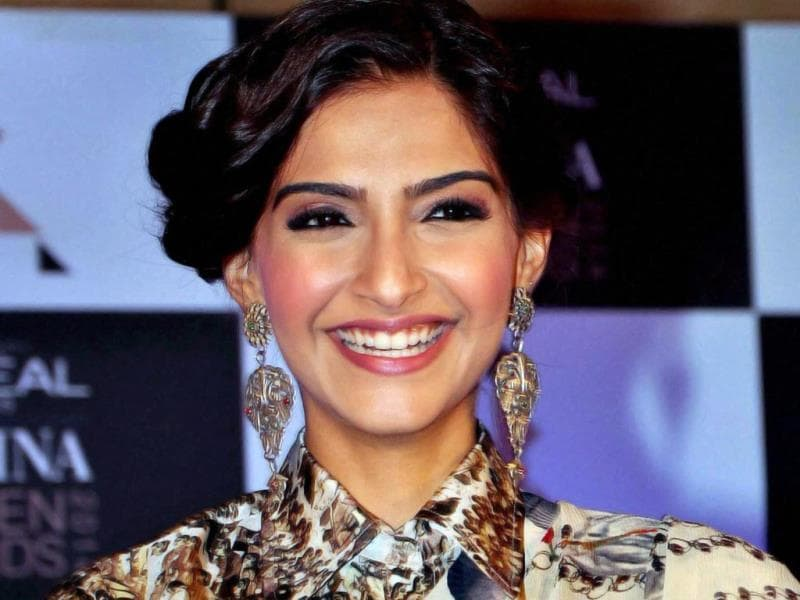 Sonam Kapoor poses for the shutterbugs during the press conference. AFP PHOTO
