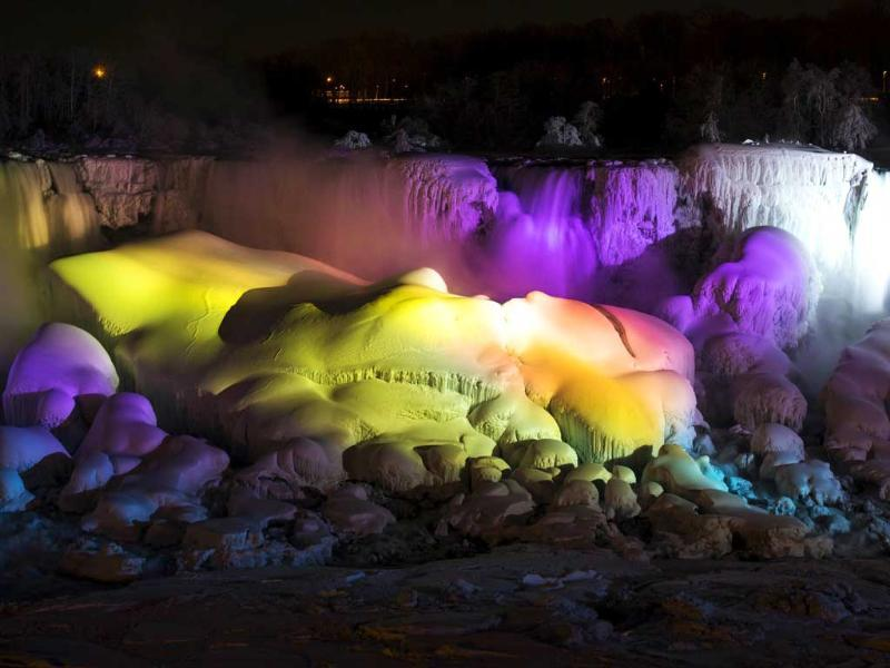 A partially frozen Niagara Falls is seen on the American side lit by lights during sub freezing temperatures. (Reuters Photo)