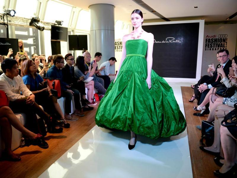 A model presents creation by designer Oscar de la Renta during a media preview for Audi Fashion Festival, which will showcase of homegrown and Asian talents. (AFP)