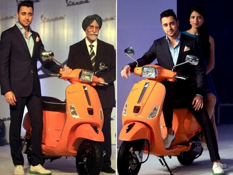 Imran Khan with Ravi Chopra, CMD Piaggio Vehicles during the launch on Wednesday. (PTI Photo)