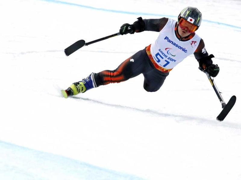 Japan's Hiraku Misawa takes a curve as he skis during the men's downhill standing training at the 2014 Sochi Paralympic Winter Games at the Rosa Khutor Alpine Center. (Reuters Photo)