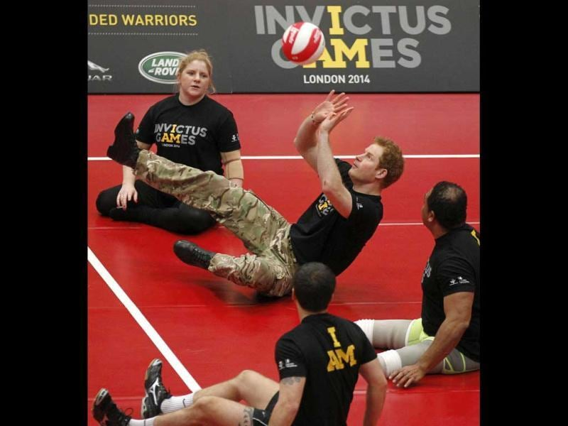 Britain's Prince Harry (C) plays a game of sitting volleyball during the launch of the Invictus Games for wounded warriors at the Copper Box arena in the Queen Elizabeth Olympic Park in London. (AP Photo)