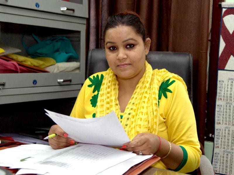 Pooja Thakur, HIV AIDS activist, in her office in Chandigarh. (Rajnish Katyal/HT Photo)