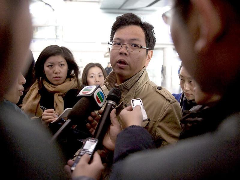 A Malaysian man who says he has relatives on board the missing Malaysian Airlines plane, talks to journalists at Beijing's International Airport Beijing, China. (AP Photo)