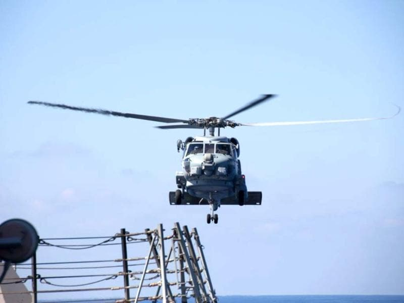 A US Navy helicopter departs from the USS Pinckney to aid in the search and rescue efforts for the missing Malaysian airlines flight MH370 in the Gulf of Thailand. (AP photo)