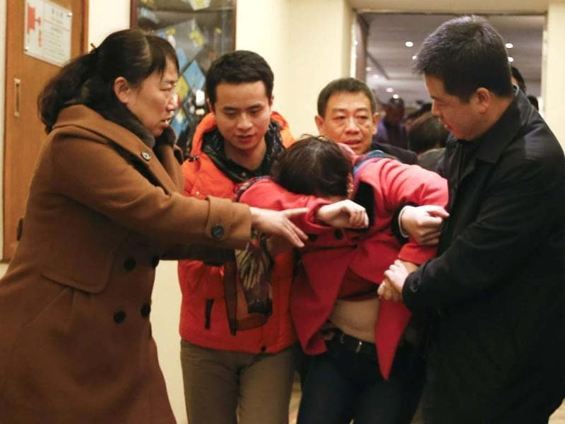 A Chinese relative of a passenger aboard the missing Malaysia Airlines plane leaves a hotel room in Beijing. (AP photo)