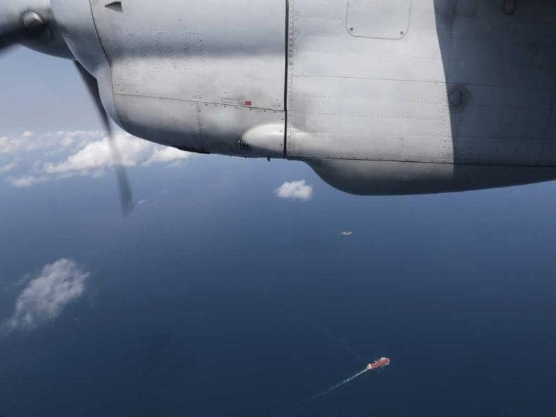 Ships are seen from a flying Soviet-made AN-26 of the Vietnam Air Force during a search operation for the missing Malaysian Airlines Boeing 777 over the South China Sea. (AP Photo)