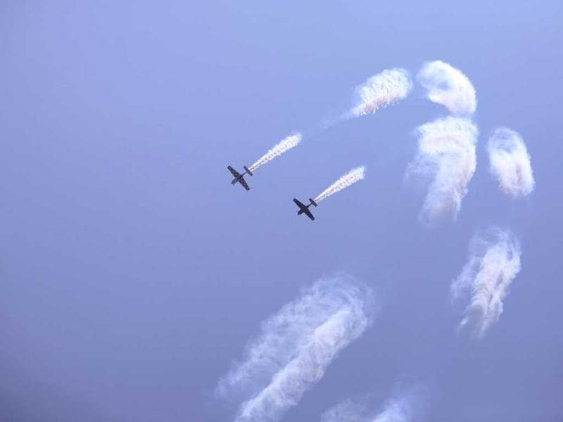 Abarth aircraft perform aerobatic display during preparations for the India Aviation show at Begumpet airport in Hyderabad, India. (AP Photo)