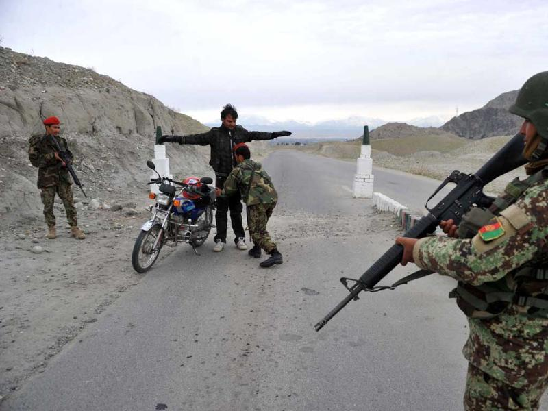 Afghan security personnel search a passenger at a checkpoint on the outskirts of Jalalabad in Nangarhar province (AFP photo)
