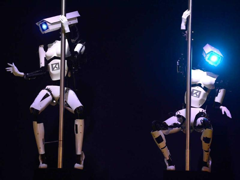 Robots perform a pole dance at the booth of the Tobit Software company on the eve of the start of the 2014 CeBIT technology trade fair in Germany. (AFP Photo)