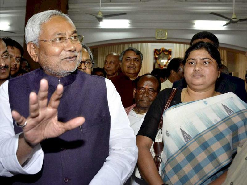 Bihar Chief Minister Nitish Kumar with the newly inducted Cabinet minister Lesi Singh at Raj Bhawan in Patna on Tuesday. PTI Photo