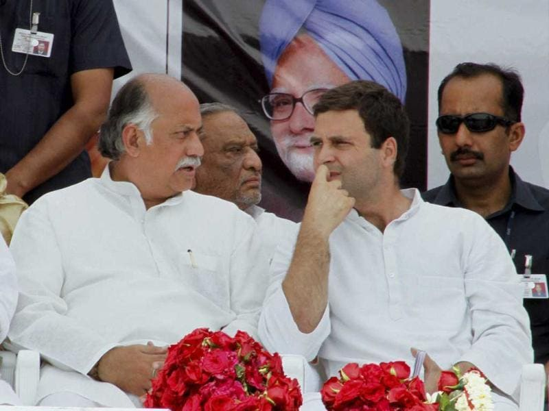 Congress Vice President Rahul Gandhi with party General secretary Gurudas Kamat during an election campaign rally at Balasinor town in Mahisagar district on Tuesday. PTI Photo