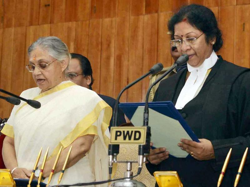 Chief Justice of Kerala High Court, Manjula Chellur administering the oath to new Governor Sheila Dikshit at a ceremony in Thiruvananthapuram on Tuesday. Kerala CM Oommen Chandy is on left. PTI Photo