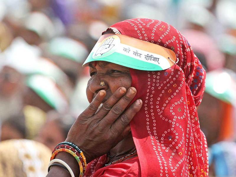 A woman listens to a speech by Congress party vice-president Rahul Gandhi during an election rally at Balasinor, Gujarat. (AP Photo)