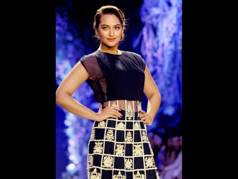 Bollywood actor Sonakshi Sinha displays a designer's collection during the opening session of Lakme Fashion Week 2014, in Mumbai on March 11. (PTI Photo)