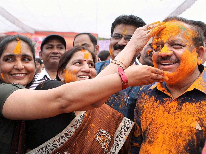 BJP workers smear colours on Delhi BJP president Harsh Vardhan during Holi celebrations at the party office in New Delhi (PTI file photo)