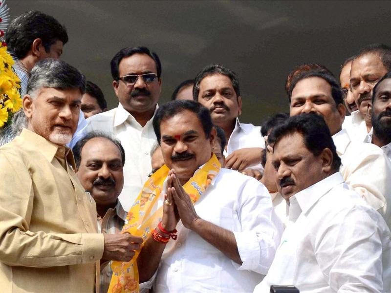 Telugu Desam Party chief N Chandrababu Naidu greeting MLA Thota Trimurthulu who resigned from the Congress recently after the latter joined TDP in Hyderabad (PTI photo)