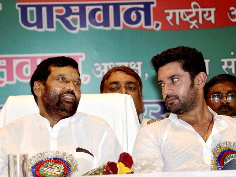 LJP chief Ram Vilas Paswan with his son and party leader Chirag Paswan at a party meeting in Patna (PTI photo)
