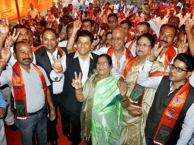 Assam BJP chief, Sarbananda Sonowal Assam (3rd L) and Bijoya Chakraborty (C), MP, with newly joined party members in Guwahati (PTI photo)