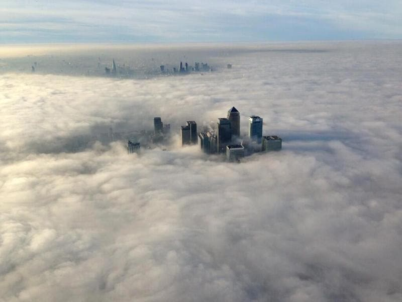 The Canary Wharf financial district (front) and central London emerge from morning fog in this aerial photograph released by the Metropolitan Police in London. (Reuters photo/Metropolitan Police)