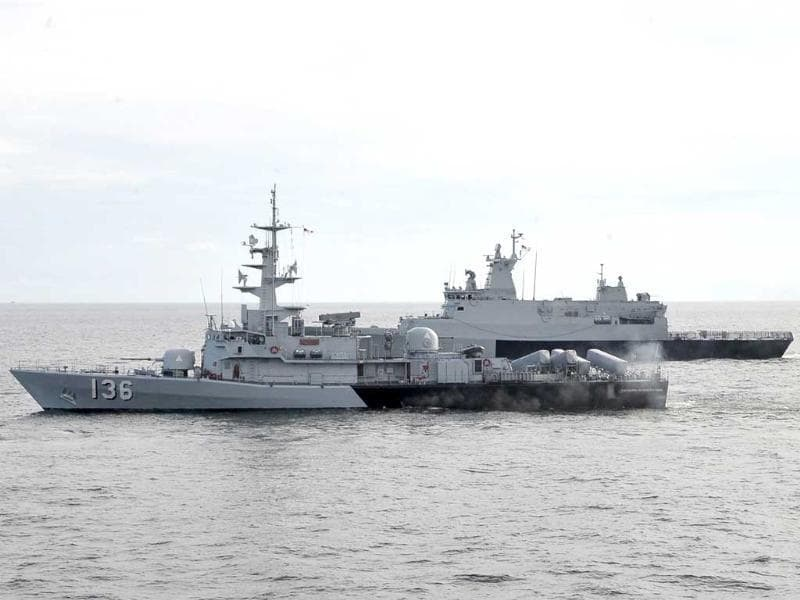 This handout photo taken shows the Royal Malaysian Navy's missile corvette KD Laksamana Muhammad Amin (front) and Royal Malaysian Navy's offshore patrol vessel KD Selangor (behind) during a search and rescue operation for the missing Malaysia Airlines plane in the Straits of Malacca off the Malaysian coast. (AFP Photo/Royal Malaysian Navy)