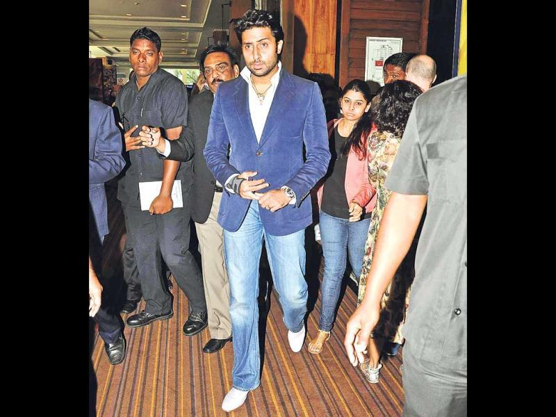 Abhishek Bachchan, surrounded by security, walks into an event in Mumbai.