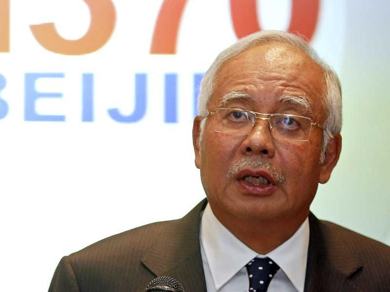 Malaysian Prime Minister Najib Razak addresses reporters about the missing Malaysia Airlines flight MH370 at Kuala Lumpur International Airport. (Reuters photo)