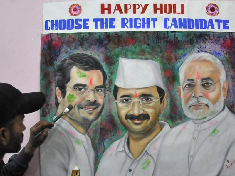 Rubal, an artist from Amritsar, outlines political colours of Lok Sabha elections through a unique portrait of Congress Vice-President Rahul Gandhi, Arvind Kejriwal, leader of Aam Aadmi Party and BJP's PM candidate Narendra Modi, on the occasion of Holi (HT photo/Sameer Sehgal)
