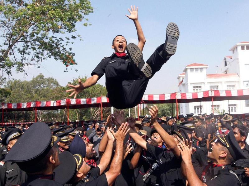 Cadets lift a colleague after a passing out parade at Officers Training Academy in Chennai. (PTI Photo)