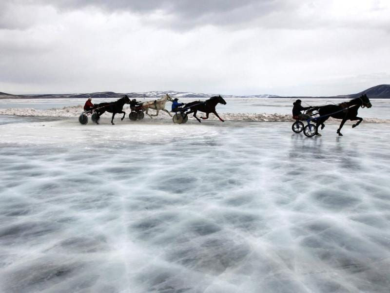 Trotters compete in a harness race on the frozen Yenisei River during the 44th Ice Derby amateur horse race near the settlement of Novosyolovo (Reuters photo)