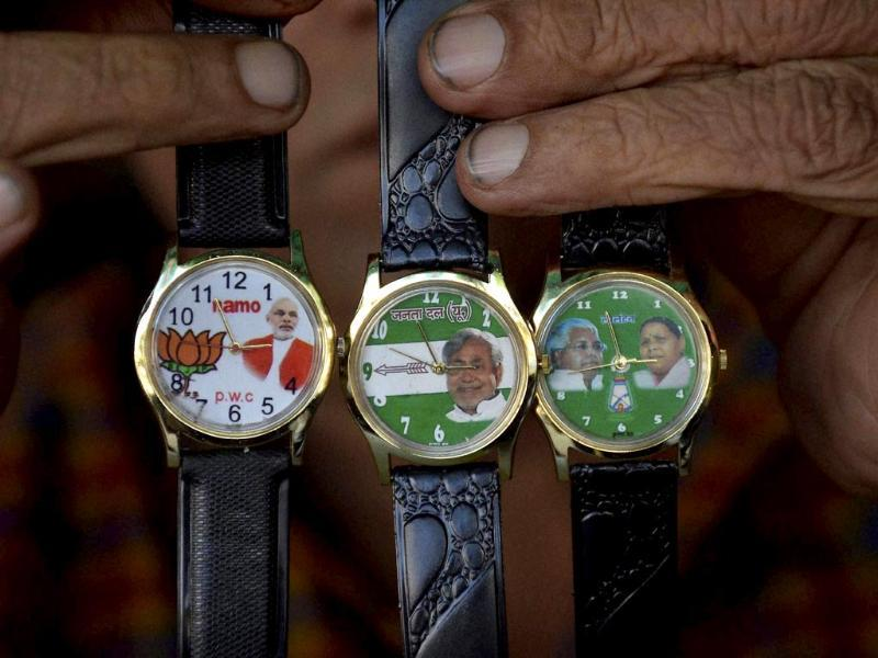 A vendor sells wrist watches with various political parties symbols embossed in them, in Patna. (PTI photo)