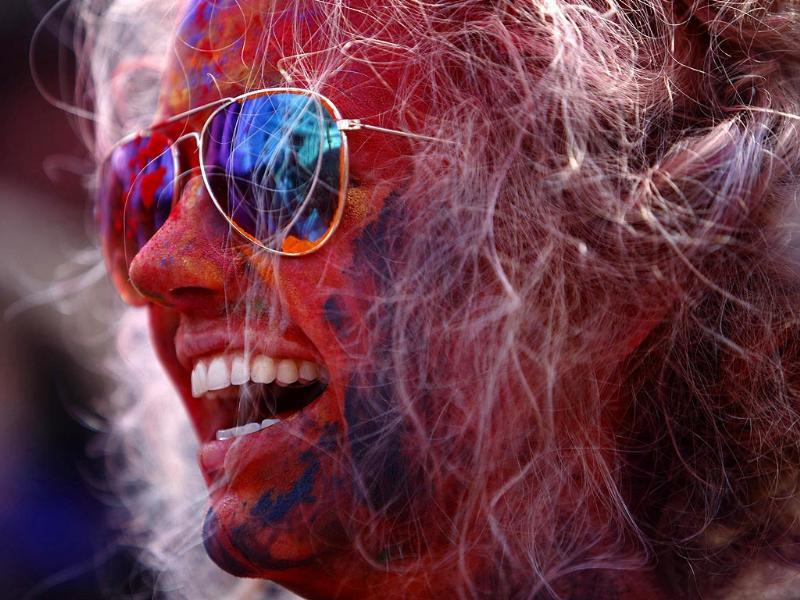 A tourist celebrates Holi in Kathmandu. Holi marks the beginning of spring and is celebrated with great enthusiasm all over Nepal. (Reuters photo)