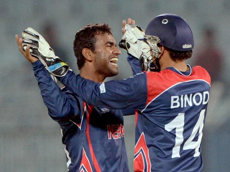 Nepalese cricketer Jitendra Mukhiya (L) celebrates with his teammate Binod Bhandari after the dismissal of the final wicket of Hong Kong's Nadeem Ahmed during the ICC World T20 at the Zohur Ahmed Chowdhury Stadium in Chittagong. (AFP Photo)