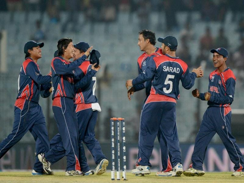 Nepal cricketers celebrate the dismissal of Hong Kong's Irfan Ahmed Naresh Budayair during the ICC World T20 match in Chittagong. (AFP Photo)