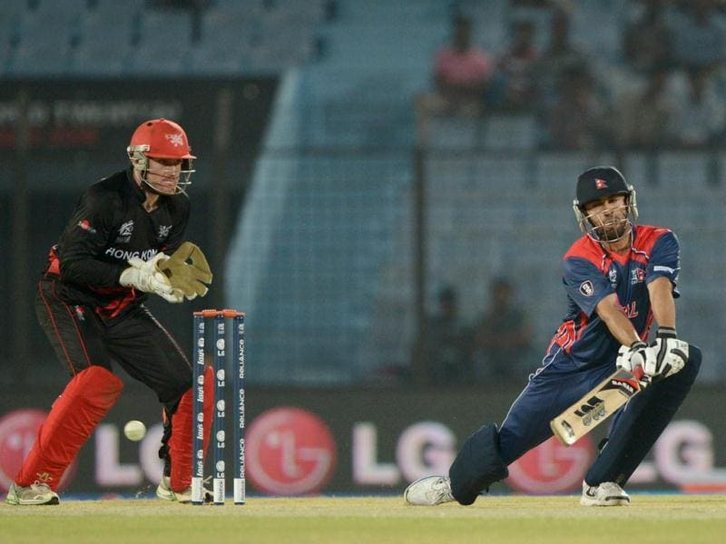 Nepal's Sharad Vesawkar (R) plays a shot as Hong Kong's Jamie Atkinson (L) looks on during their ICC World T20 match in Chittagong. (AFP Photo)