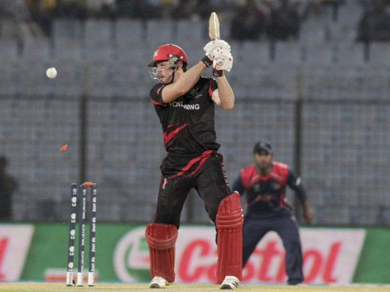 Hong Kong's Jamie Atkinson is bowled out during their ICC World T20 match against Nepal in Chittagong. (AP Photo)