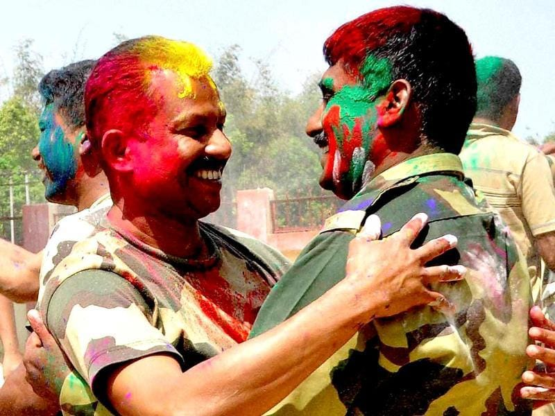 Border Security Force (BSF) personnel celebrate Holi at Bangladesh border near Agartala. (PTI Photo)