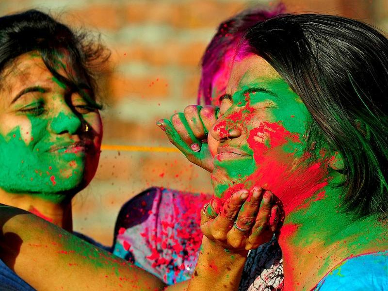 Girls play with colours during Holi celebrations. (Agencies)