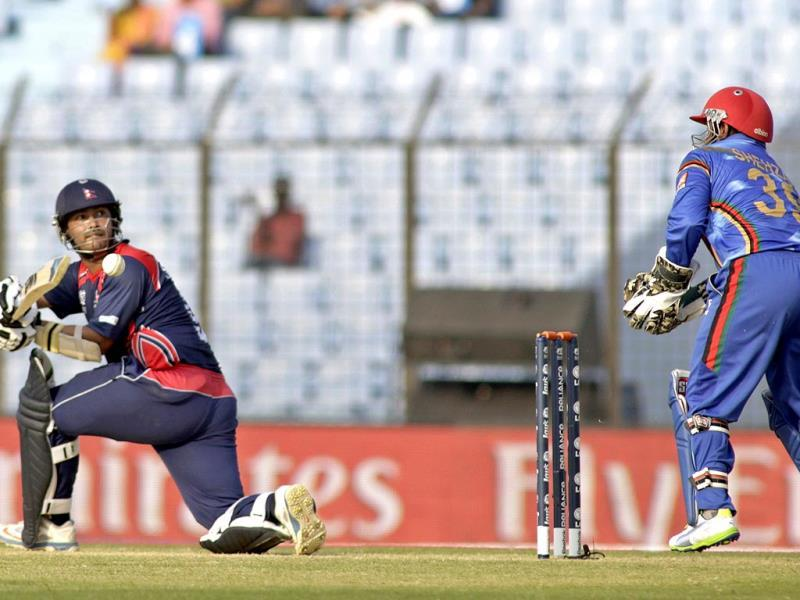 Nepal's Subash Khakurel plays a shot as Afghanistan's wicketkeeper Mohammad Shahzad (R) watches during their World T20 match in Chittagong. (AP Photo)