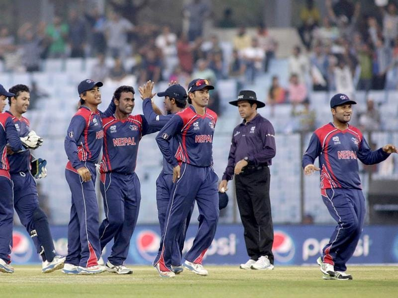 Nepalese players celebrate the fall of an Afghanistan wicket during their World T20 match in Chittagong. (AP Photo)