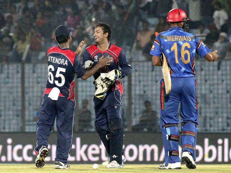 Nepal's Subash Khakurel (2nd R) and Jitendra Mukhiya celebrate after defeating Afghanistan by nine runs during their World T20 match in Chittagong. (AP Photo)