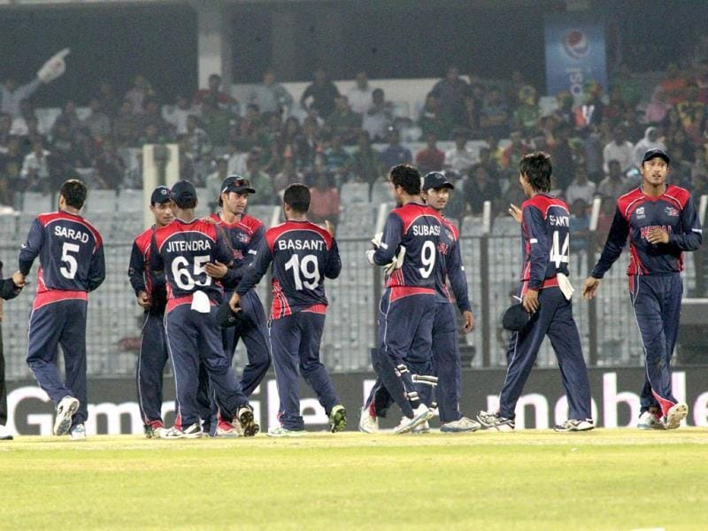 Nepalese cricketers celebrate after defeating Afghanistan by nine runs during their World T20 match in Chittagong. (AP Photo)