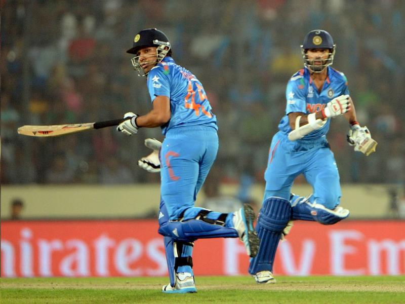 Rohit Sharma (L) and Shikhar Dhawan run between the wickets during their ICC World Twenty20 match against Pakistan at the Sher-e-Bangla National Cricket Stadium in Dhaka. (AFP Photo)