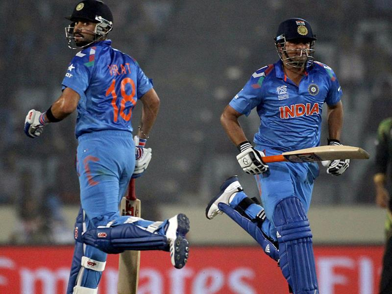 Virat Kohli (L) and Suresh Raina run between the wickets against Pakistan during their match of ICC World Twenty20 World Cup at the Sher-E-Bangla National Cricket Stadium in Dhaka. (Reuters Photo)