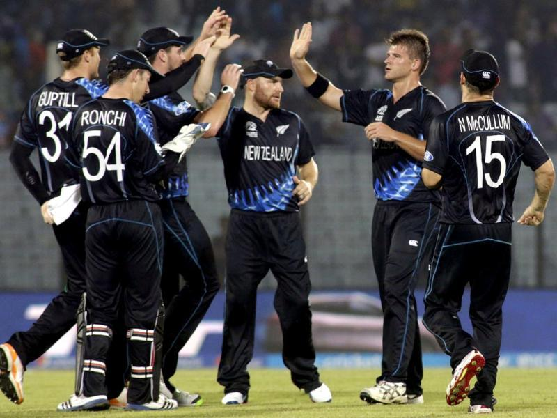 New Zealand's Brendon McCullum (C) celebrates with teammates the dismissal of an England wicket during their ICC World Twenty20 match in Chittagong. (AP Photo)