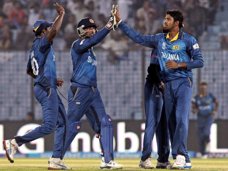 Sri Lanka's Sachithra Senanayake (R) celebrates with teammates the dismissal of South Africa's Hashim Amla during their ICC World Twenty20 match in Chittagong. (AP Photo)