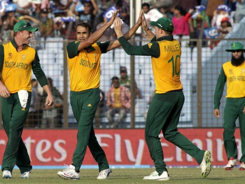 South Africa's player Imran Tahir (2L) celebrates with David Miller and AB de Villiers (L) the dismissal of a Sri Lankan wicket during their ICC World Twenty20 match in Chittagong. (AP Photo)