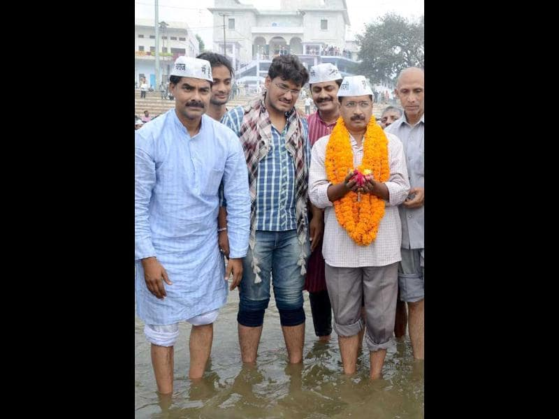 Arvind Kejriwal poses for a photograph as he visits the river Ganges in Varanasi. AFP