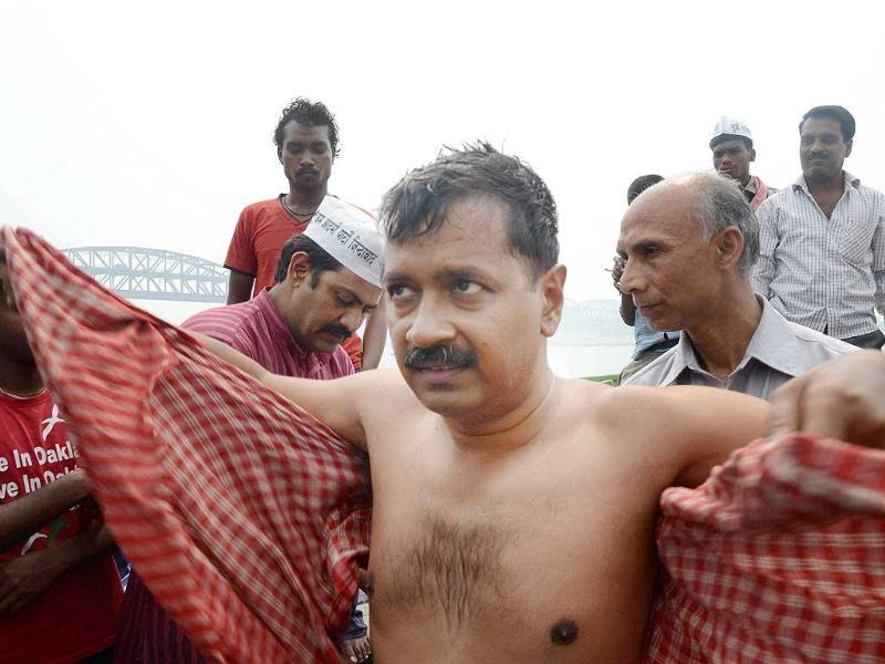AAP convener Arvind KejriArvind Kejriwalwal after taking holy dip River Ganga at Rajghat in Varanasi on Tuesday. PTI Photo