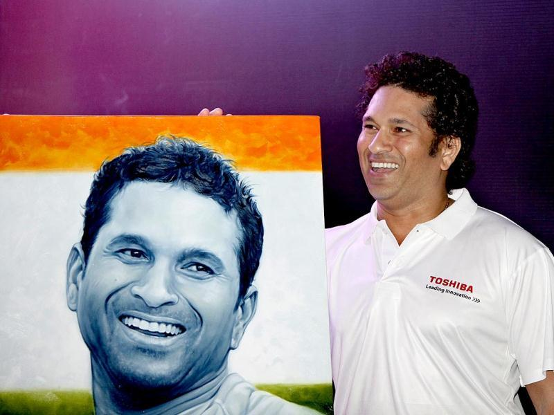 Sachin Tendulkar stands beside his portrait at an event as Toshiba India pays tribute to the living legend with world's largest photo mosaic of a cricketer at Taj Lands End in Bandra, Mumbai. (HT Photo/Kalpak Pathak)